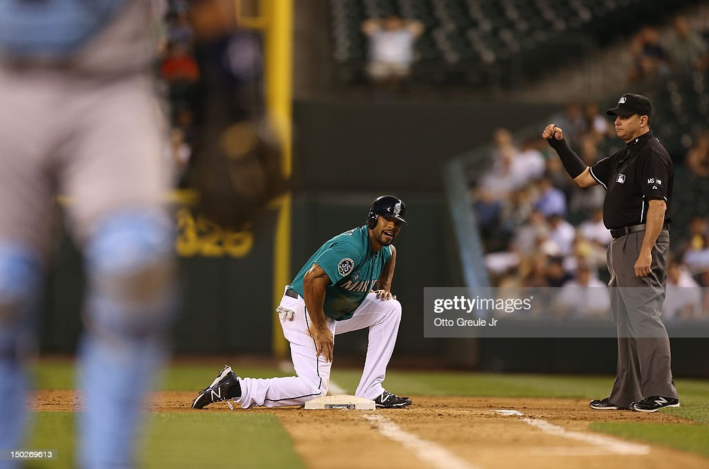 <a gi-track='captionPersonalityLinkClicked' href=/galleries/search?phrase=Eric+Thames&family=editorial&specificpeople=7509145 ng-click='$event.stopPropagation()'>Eric Thames</a> #10 of the Seattle Mariners gets up after being picked off of first base against the Tampa Bay Rays at Safeco Field on August 13, 2012 in Seattle, Washington.