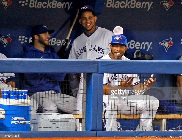 Eric Thames of the Toronto Blue Jays reacts to having a bubble gum bubble stuck to his hat against the Baltimore Orioles during MLB action at the...