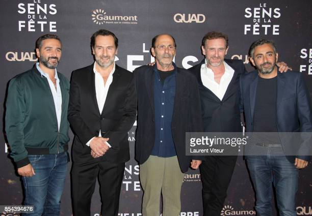 Eric Toledano Gilles Lellouche JeanPierre Bacri JeanPaul Rouve and Olivier Nakache attend 'Le Sens De La Fete' Paris Premiere at Le Grand Rex on...
