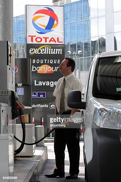 Eric Trideau fills his car at a Total SA gas station in Paris France on Thursday July 23 2009 Total SA releases its firsthalf earnings on July 31