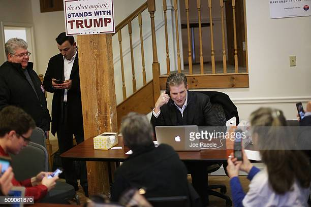 Eric Trump calls voters asking them to vote for his father Republican presidential canddiate Donald Trump while visiting with volunteers at the...