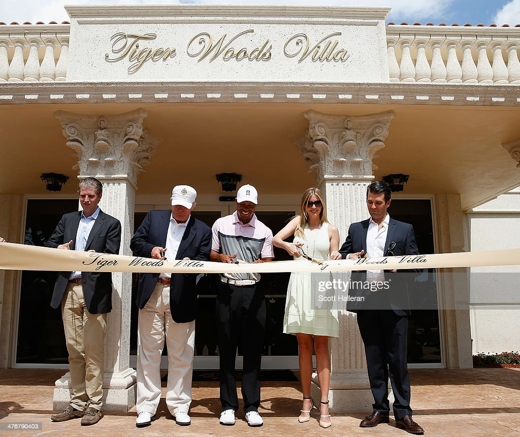 Eric Trump, Donald Trump, Tiger Woods, Ivanka Trump and Donald Trump Jr. cut a ribbon in front of the Tiger Woods Villa prior to the start of the World Golf Championships-Cadillac Championship at Trump National Doral on March 5, 2014 in Doral, Florida.