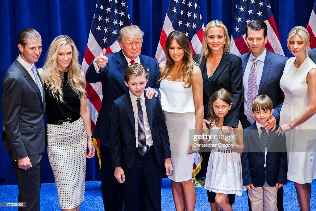Eric Trump, Lara Yunaska Trump, Donald Trump, Barron Trump, Melania Trump, Vanessa Haydon Trump, Kai Madison Trump, Donald Trump Jr., Donald John Trump III, and Ivanka Trump pose for photos on stage after Donald Trump announced his candidacy for the U.S. presidency at Trump Tower on June 16, 2015 in New York City. Trump is the 12th Republican who has announced running for the White House.