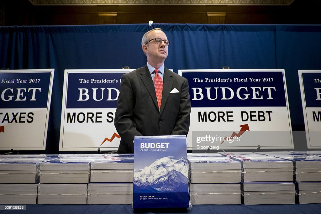 Eric Ueland, a staff member with the Senate Budget Committee, stands behind copies of U.S. President Barack Obama's Fiscal Year 2017 Budget in Washington, D.C., U.S., on Tuesday, Feb. 9, 2016. Obama will send a fiscal 2017 budget of about $4 trillion to the Republican-controlled Congress on Tuesday representing his aspirations for the future of the U.S. Photographer: Pete Marovich/Bloomberg via Getty Images