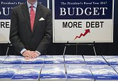 Eric Ueland of the Senate Budget Committee distributes copies of US President Barack Obama's Fiscal Year 2017 budget on Capitol Hill in Washington DC...