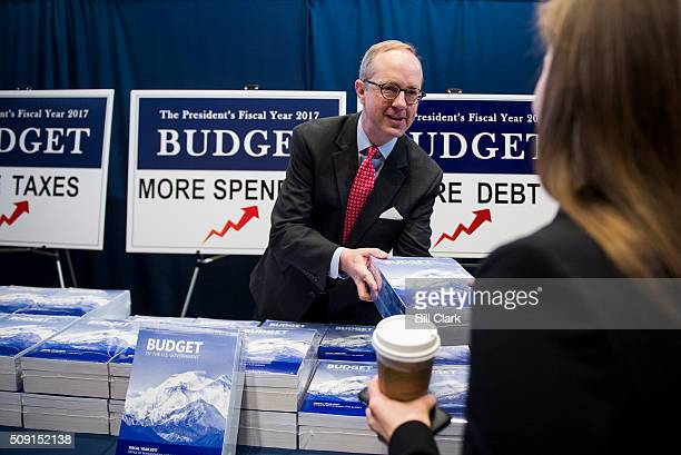 Eric Ueland staff director for the Senate Budget Committee hands out printed copies of the Presidents FY2017 Budget to staffers in the Senate Budget...