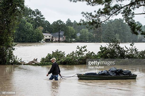 Eric Van Sant rescues possessions from a flooded home in the Forest Acres neighborhood October 5 2015 in Columbia South Carolina The state of South...