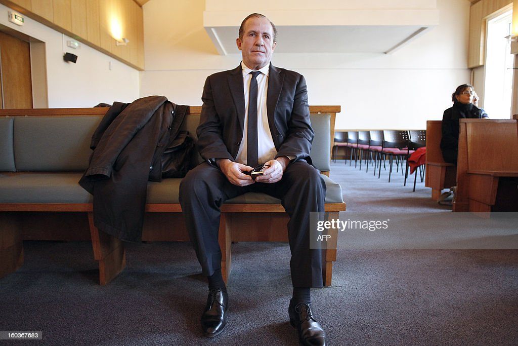 Eric Vannier (L), mayor of the Mont-Saint-Michel, head of the famous 'Mère Poulard' institution, waits at the correctional court of Coutances on January 30, 2013. Eric Vannier appears at the correctional court for 'illegal taking of interest' after a complaint from political and commercial rival, Patrick Gaulois, at the foot of one of the most visited sites in the world.