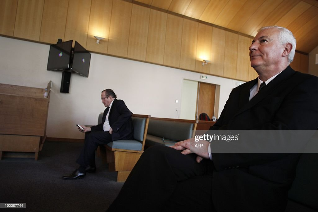 Eric Vannier (L), mayor of the Mont-Saint-Michel, head of the famous 'Mère Poulard' institution, waits at the correctional court of Coutances on January 30, 2013. Eric Vannier appears at the correctional court for 'illegal taking of interest' after a complaint from political and commercial rival, Patrick Gaulois (R), at the foot of one of the most visited sites in the world. AFP PHOTO/CHARLY TRIBALLEAU.