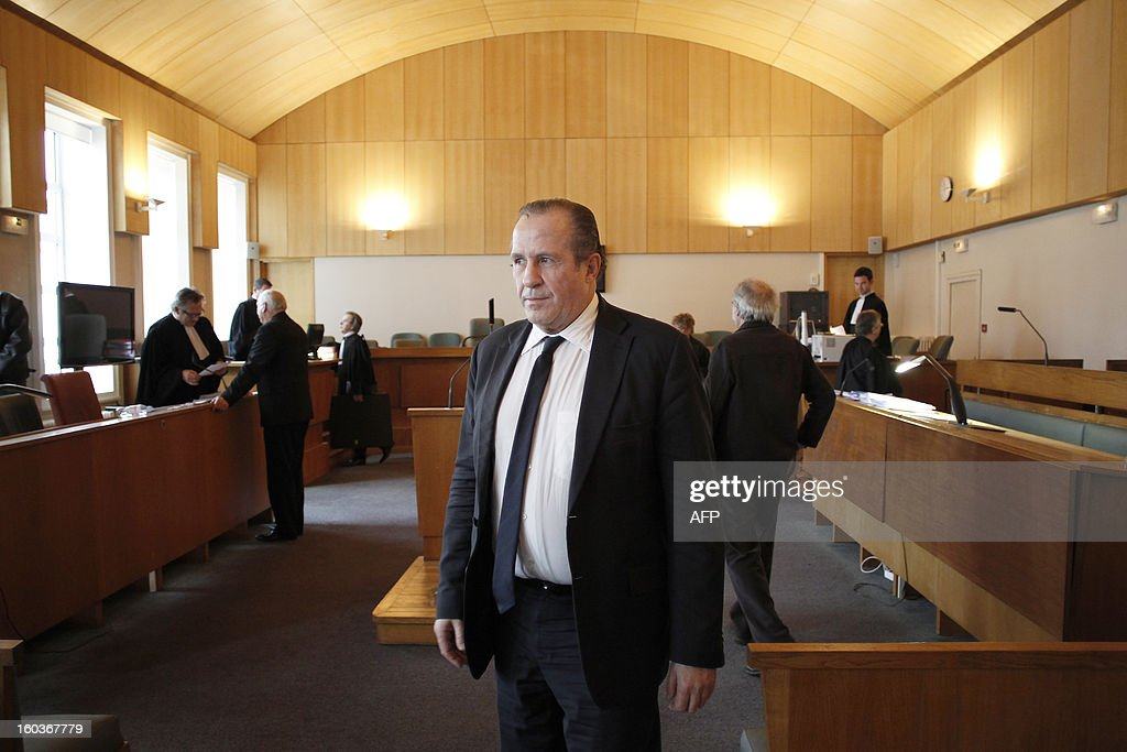 Eric Vannier (C), mayor of the Mont-Saint-Michel, head of the famous 'Mère Poulard' institution, waits at the correctional court of Coutances on January 30, 2013. Eric Vannier appears at the correctional court for 'illegal taking of interest' after a complaint from political and commercial rival, Patrick Gaulois, at the foot of one of the most visited sites in the world. AFP PHOTO/CHARLY TRIBALLEAU. Photo prise le 30 janvier 2013 à Coutances d'Eric Vannier maire du Mont-Saint-Michel. Eric Vannier, 60 ans, sans étiquette, est soupçonné d'avoir usé de son statut d'élu pour faire en sorte que le point de départ des navettes, qui depuis le 28 avril 2012 transportent les touristes de la côte au célèbre site touristique, se trouve devant ses établissements. Le jugement dans l'affaire du maire du Mont-Saint-Michel, Eric Vannier, poursuivi pour prise illégale d'intérêt sera rendu le 27 mars 2013 à Coutances.