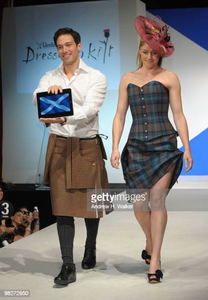 Eric Villency walks the runway with the iPad at the 8th annual 'Dressed To Kilt' Charity Fashion Show presented by Glenfiddich at M2 Ultra Lounge on...