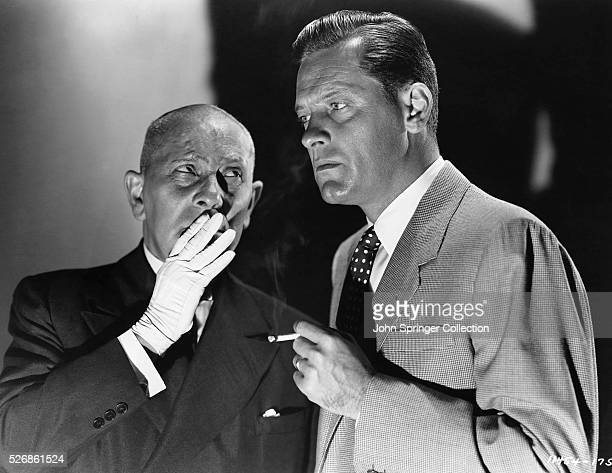 Eric von Stroheim as Max Von Mayerling whispers to William Holden in the role of Joe Gillis in the 1940 movie Sunset Boulevard