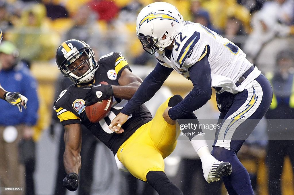 Eric Weddle #32 of the San Diego Chargers hits Jerricho Cotchery #89 of the Pittsburgh Steelers during the game on December 9, 2012 at Heinz Field in Pittsburgh, Pennsylvania.