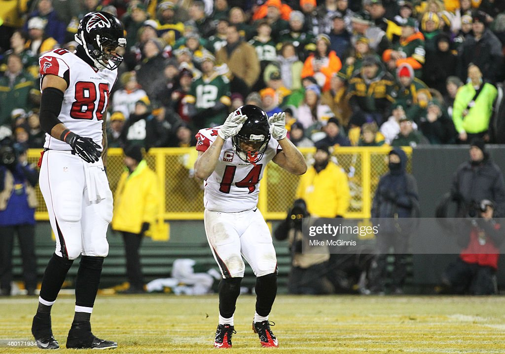 Eric Weems #14 of the Atlanta Falcons celebrates his touchdown in the third quarter against the Green Bay Packers at Lambeau Field on December 8, 2014 in Green Bay, Wisconsin.