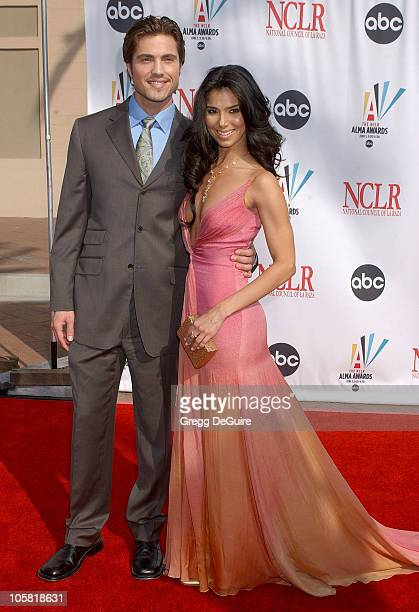 Eric Winter and Roselyn Sanchez during 2006 NCLR ALMA Awards Arrivals at Shrine Auditorium in Los Angeles California United States