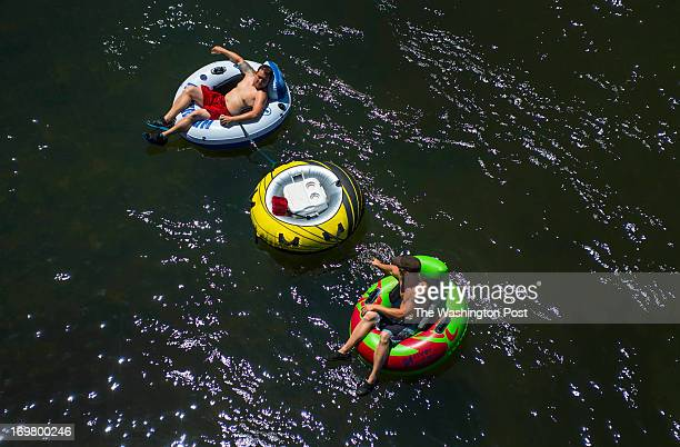 Eric Winters of Middletown Md top and his friend Jimmy King of Charles Town WV enjoy the hot day floating down the Potomac River on May 31 2013 in...