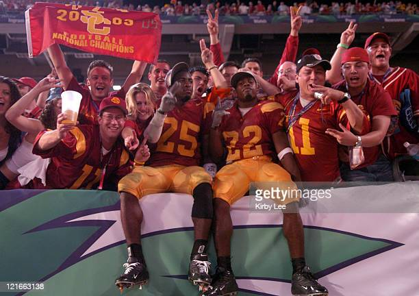 Eric Wright and Demnond Reed of USC celebrate with fans after 5519 victory over Oklahoma in the FedEx Orange Bowl at Pro Player Stadium in Miami...