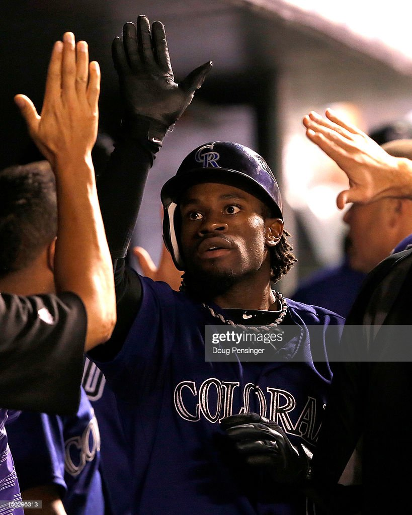 Eric Young Jr. #1 of the Colorado Rockies celebrates his two run home run off of Jose Veras #40 of the Milwaukee Brewers to give the Rockies a 8-2 lead in the sixth inning at Coors Field on August 14, 2012 in Denver, Colorado. The Rockies defeated the Brewers 8-6.