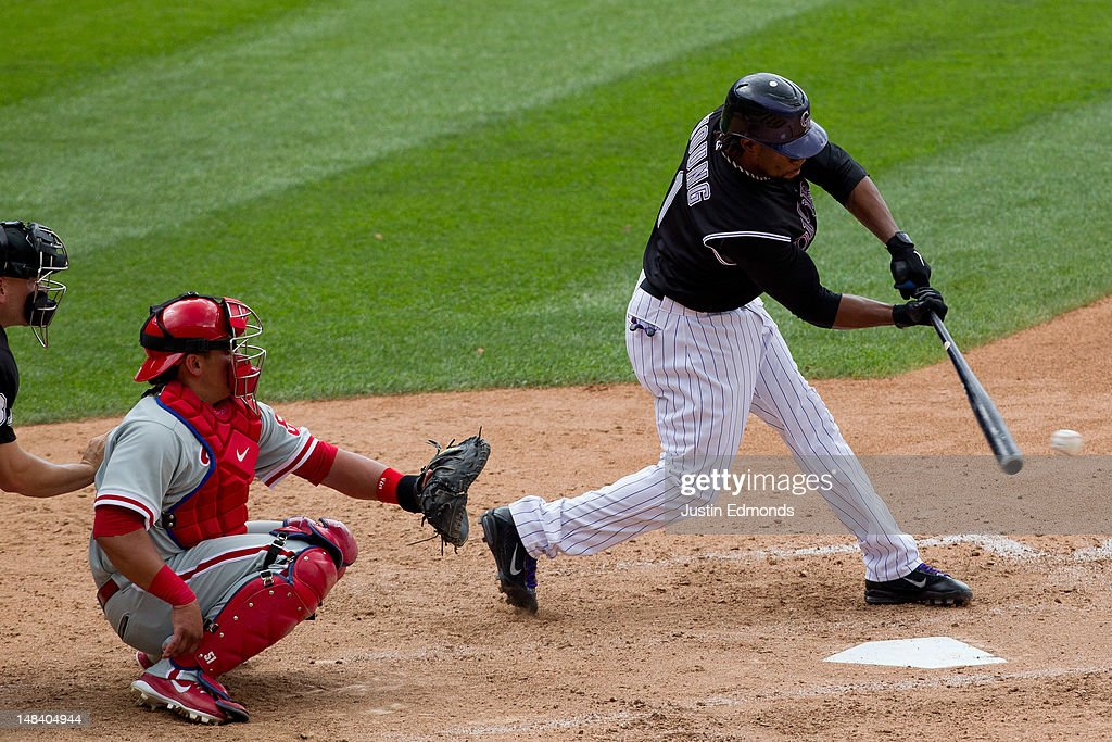 Eric Young Jr. #1 of the Colorado Rockies gets a pinch hit single to center field to lead off the eighth inning against the Philadelphia Phillies at Coors Field on July 15, 2012 in Denver, Colorado. The Phillies defeated the Rockies 5-1.