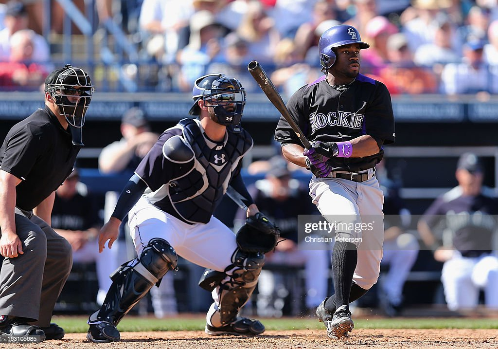 Eric Young Jr. #1 of the Colorado Rockies hits a RBI single against the Seattle Mariners during the fourth inning of the spring training game at Peoria Stadium on March 4, 2013 in Peoria, Arizona.