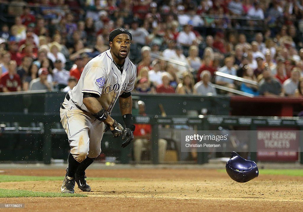 Eric Young Jr. #1 of the Colorado Rockies reacts after scoring a run against the Arizona Diamondbacks during the sixth inning of the MLB game at Chase Field on April 28, 2013 in Phoenix, Arizona.