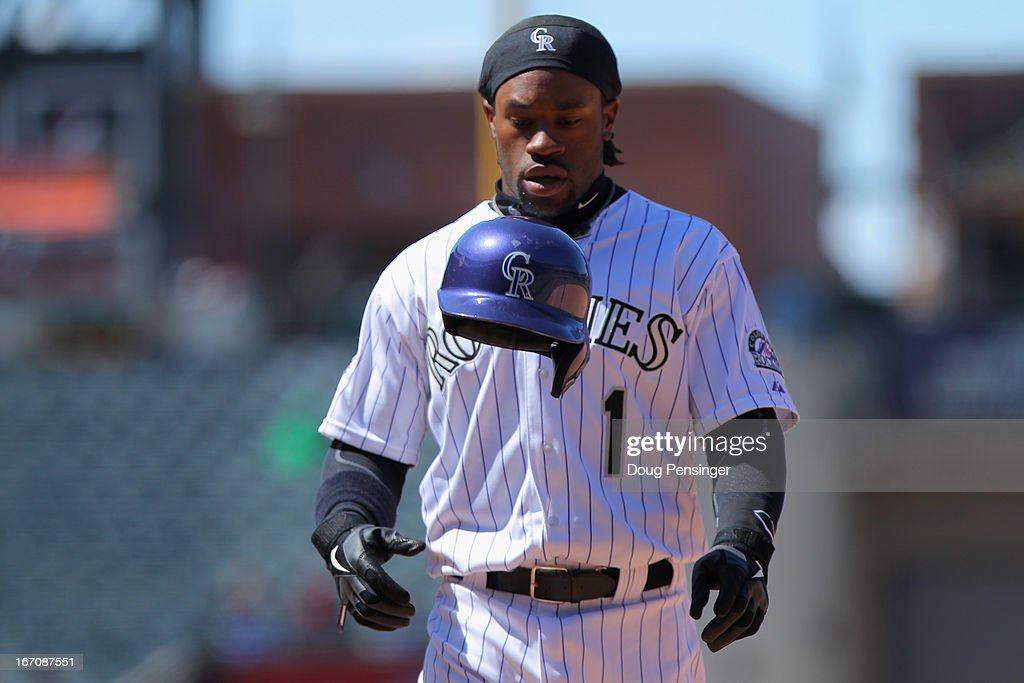 Eric Young Jr. #1 of the Colorado Rockies tosses his helmet after being caught in a rundown against the New York Mets at Coors Field on April 18, 2013 in Denver, Colorado. The Rockies defeated the Mets 11-3.