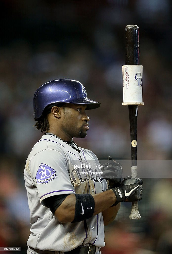 Eric Young Jr. #1 of the Colorado Rockies warms up on deck during the MLB game against the Arizona Diamondbacks at Chase Field on April 28, 2013 in Phoenix, Arizona.