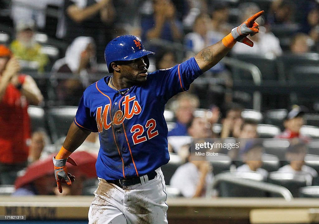 Eric Young Jr. #22 of the New York Mets after scoring on Marlon Byrd #6 RBI double in the fifth inning against the Washington Nationals at Citi Field on June 28, 2013 at Citi Field in the Flushing neighborhood of the Queens borough of New York City. Nationals defeated the Mets 6-4.