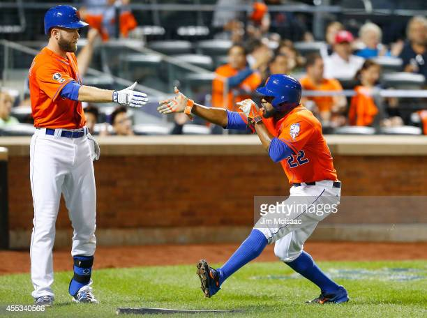 Eric Young Jr #22 of the New York Mets celebrates fifth inning run against the Washington Nationals with teammate Eric Campbell at Citi Field on...
