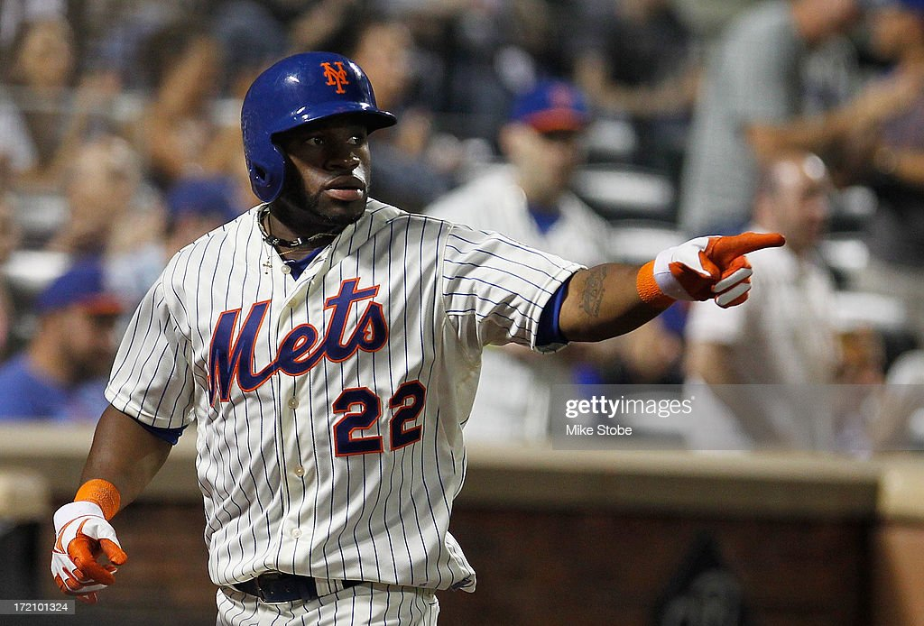 Eric Young Jr. #22 of the New York Mets gestures after scoring on <a gi-track='captionPersonalityLinkClicked' href=/galleries/search?phrase=David+Wright+-+Baseball+Player&family=editorial&specificpeople=209172 ng-click='$event.stopPropagation()'>David Wright</a> #5 RBI single in the seventh inning against the Arizona Diamondbacks at Citi Field on July 1, 2013 at Citi Field in the Flushing neighborhood of the Queens borough of New York City.