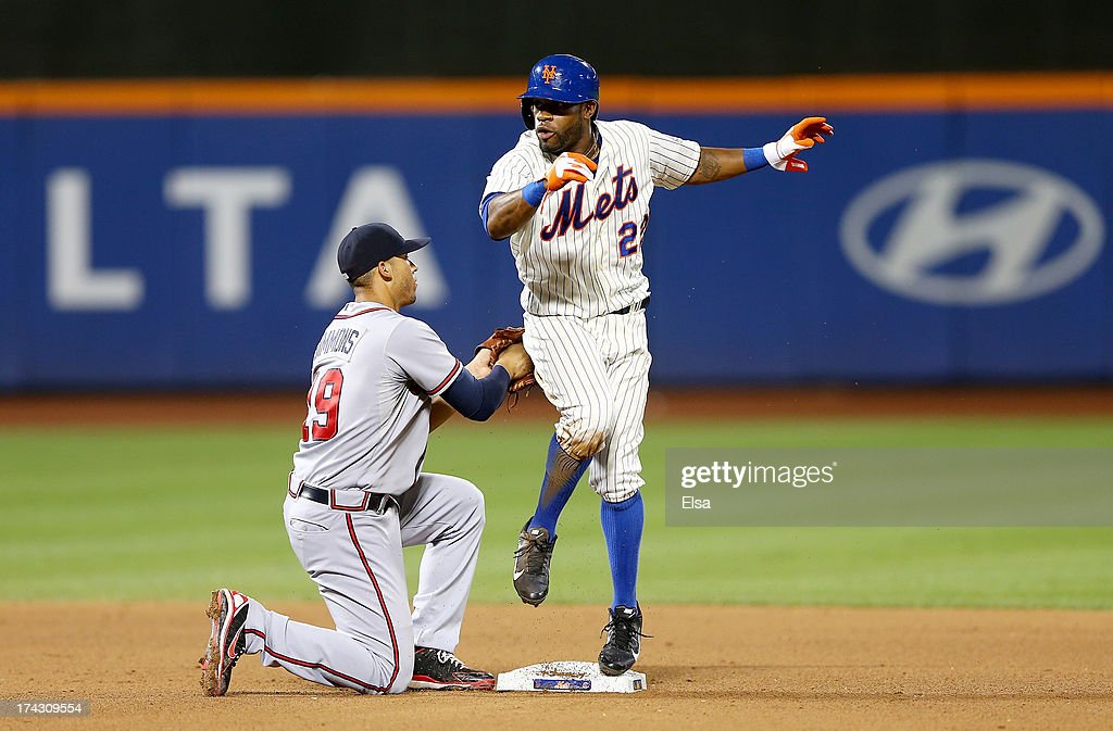 Eric Young Jr. #22 of the New York Mets is called out after trying to steal second base in the seventh inning as Andrelton Simmons #19 of the Atlanta Braves tags on July 23, 2013 at Citi Field in the Flushing neighborhood of the Queens borough of New York City.