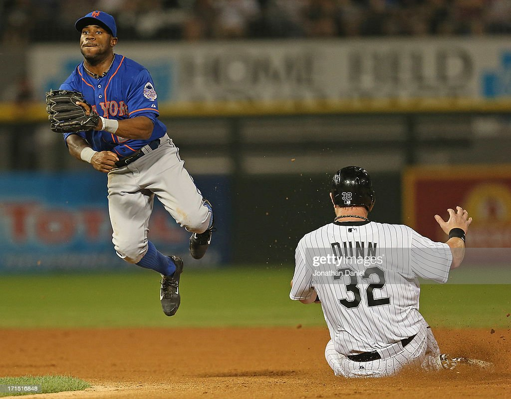 Eric Young Jr. #22 of the New York Mets leaps trying to turn a double play as <a gi-track='captionPersonalityLinkClicked' href=/galleries/search?phrase=Adam+Dunn&family=editorial&specificpeople=213505 ng-click='$event.stopPropagation()'>Adam Dunn</a> #32 of the Chicago White Sox slides into second base at U.S. Cellular Field on June 25, 2013 in Chicago, Illinois. The White Sox defeated the Mets 5-4.