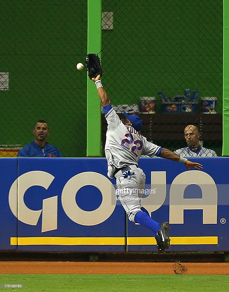 Eric Young Jr. #22 of the New York Mets misses a fly ball during a game against the Miami Marlins at Marlins Park on July 31, 2013 in Miami, Florida.
