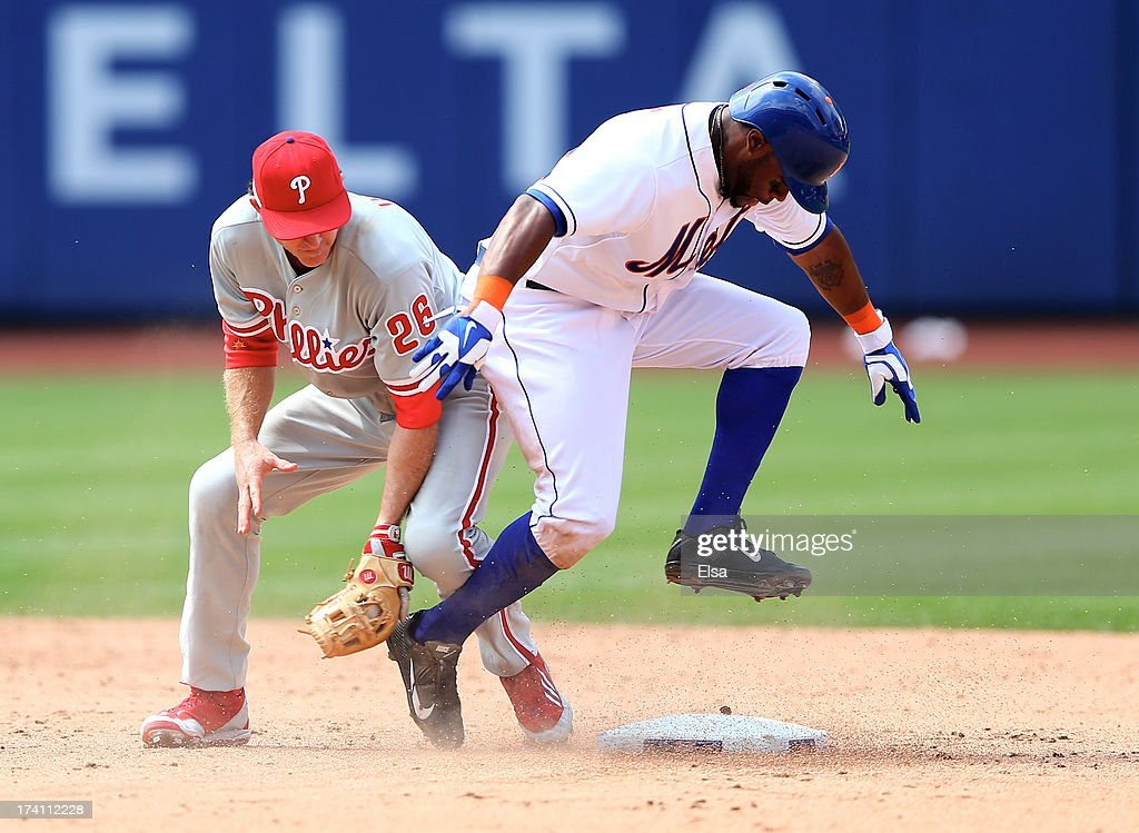 Eric Young Jr. #22 of the New York Mets safely makes it to second base after hitting a double while <a gi-track='captionPersonalityLinkClicked' href=/galleries/search?phrase=Chase+Utley&family=editorial&specificpeople=161391 ng-click='$event.stopPropagation()'>Chase Utley</a> #26 of the Philadelphia Phillies defends on July 20, 2013 at Citi Field in the Flushing neighborhood of the Queens borough of New York City. The New York Mets defeated the Philadelphia Phillies 5-4.