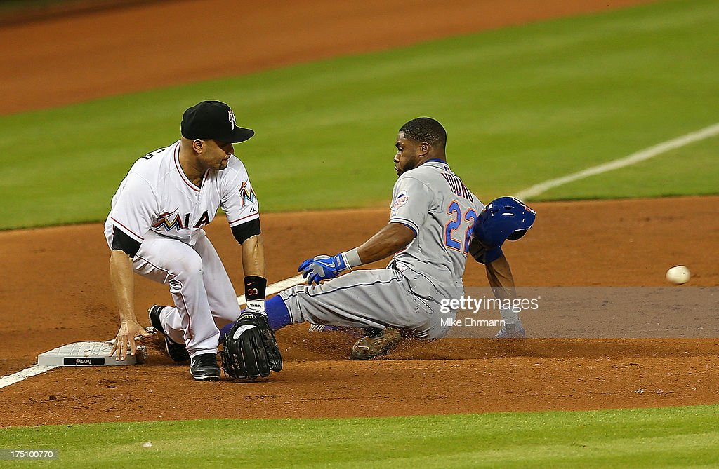 Eric Young Jr. #22 of the New York Mets slides into third as <a gi-track='captionPersonalityLinkClicked' href=/galleries/search?phrase=Placido+Polanco&family=editorial&specificpeople=213170 ng-click='$event.stopPropagation()'>Placido Polanco</a> #30 of the Miami Marlins fields the throw during a game at Marlins Park on July 31, 2013 in Miami, Florida.