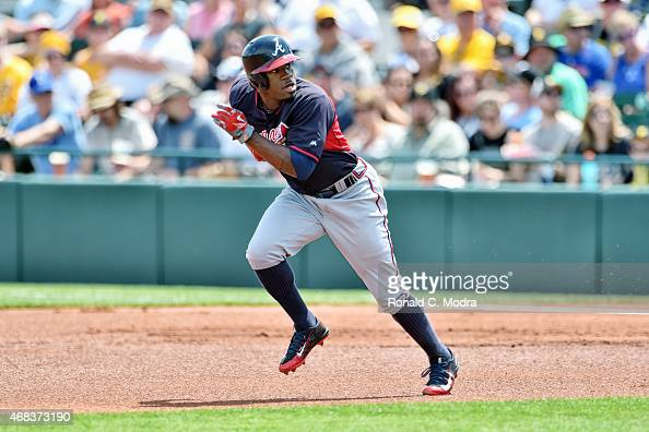 Eric Young Jr #4 of the Atlanta Braves runs to second base during a spring training game against the Pittsburgh Pirates on March 26 2015 at McKechnie...