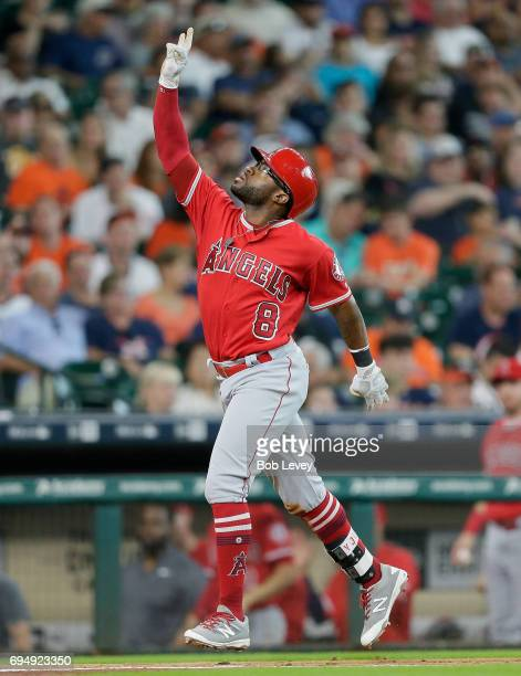 Eric Young Jr #8 of the Los Angeles Angels of Anaheim celebrates hitting a threerun home run in the fifth inning against the Houston Astros at Minute...