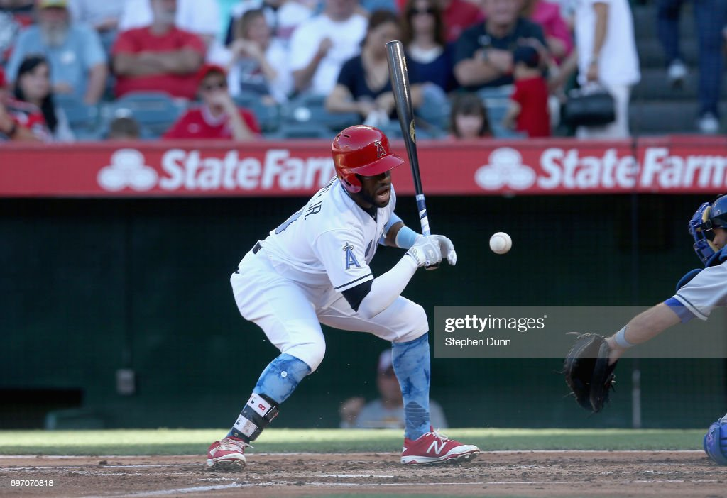 Eric Young Jr. #8 of the Los Angeles Angels of Anaheim reacts after being hit by a pitch in the second inning against the Kansas City Royals at Angel Stadium of Anaheim on June 17, 2017 in Anaheim, California.