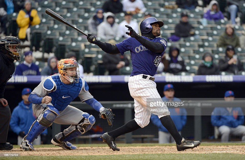 Eric Young Jr. of the Colorado Rockies hits a triple and drives in Jordan Pacheco during the eighth inning agains the New York Mets April 16, 2013 at Coors Field.