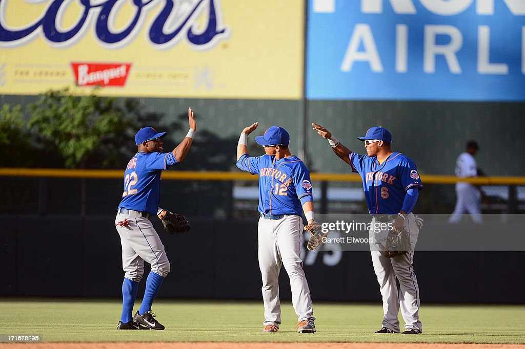 Eric Young #22, Juan Lageres #12 and Marion Byrd #6 of the New York Mets celebrate after defeating the Colorado Rockies 3-2 at Coors Field on June 27, 2013 in Denver, Colorado.