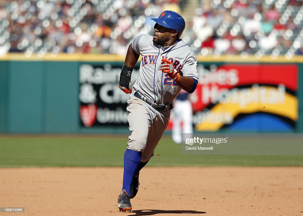 Eric Young #22 of the New York Mets goes from first to third base on a double by teammate Daniel Murphy #28 (not pictured) during the eighth inning against the Cleveland Indians on September 8, 2013 at Progressive Field in Cleveland, Ohio. The Mets defeated the Indians 2-1.