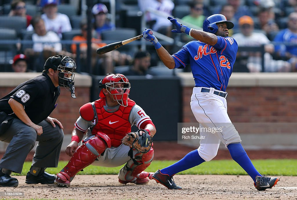Eric Young #22 of the New York Mets hits a basses loaded triple in the seventh inning against the Philadelphia Phillies on August 29, 2013 at Citi Field in the Flushing neighborhood of the Queens borough of New York City.