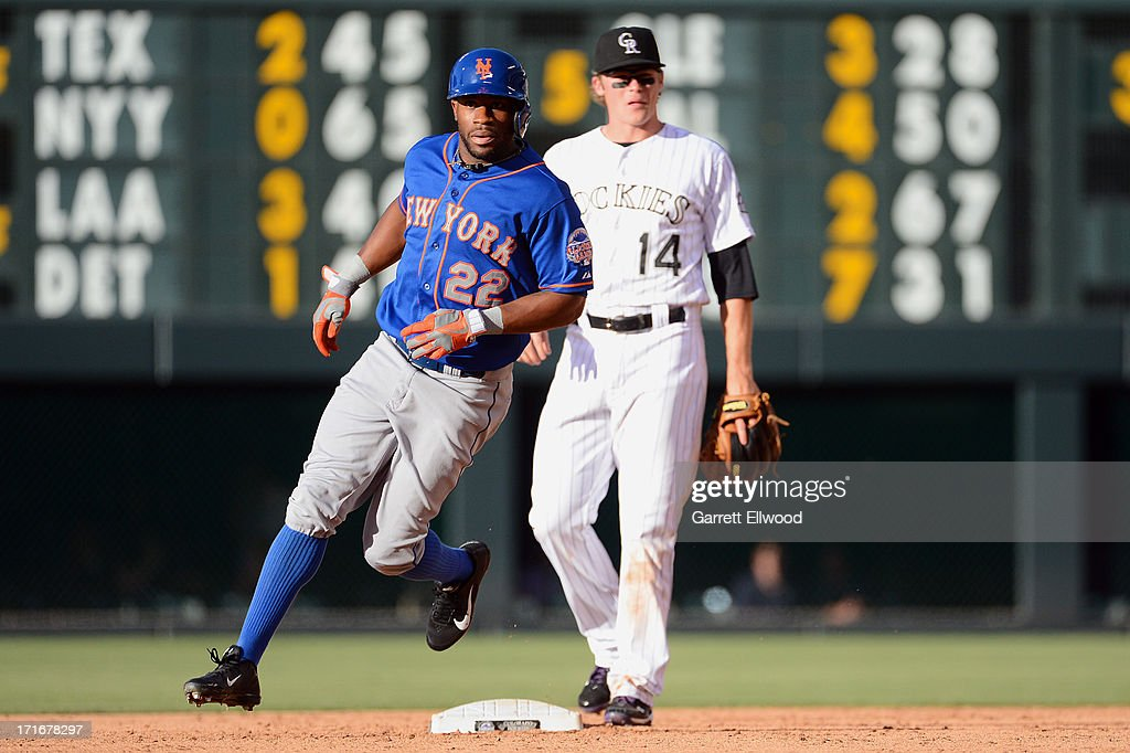 Eric Young #22 of the New York Mets rounds second base during the game against the Colorado Rockies at Coors Field on June 27, 2013 in Denver, Colorado. Photo by Garrett W. Ellwood/Getty Images)