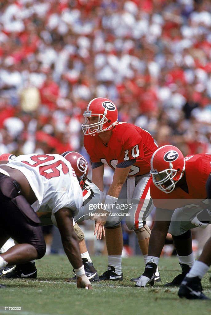 Eric Zeier of the Georgia Bulldogs prepares to snap the ball against the South Carolina Gamecocks in 1993 at Sanford Stadium in Athens Georgia