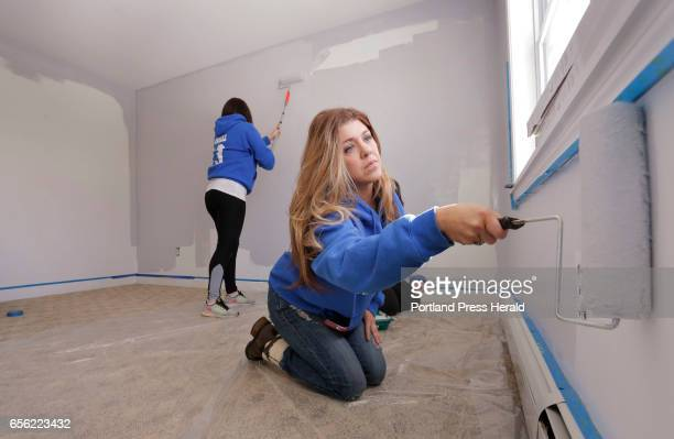 Erica Albair right and Rose Bowdoin paint a room in a house on Monday March 20 2017 in Old Orchard Beach that is being donated to the Doucette family...
