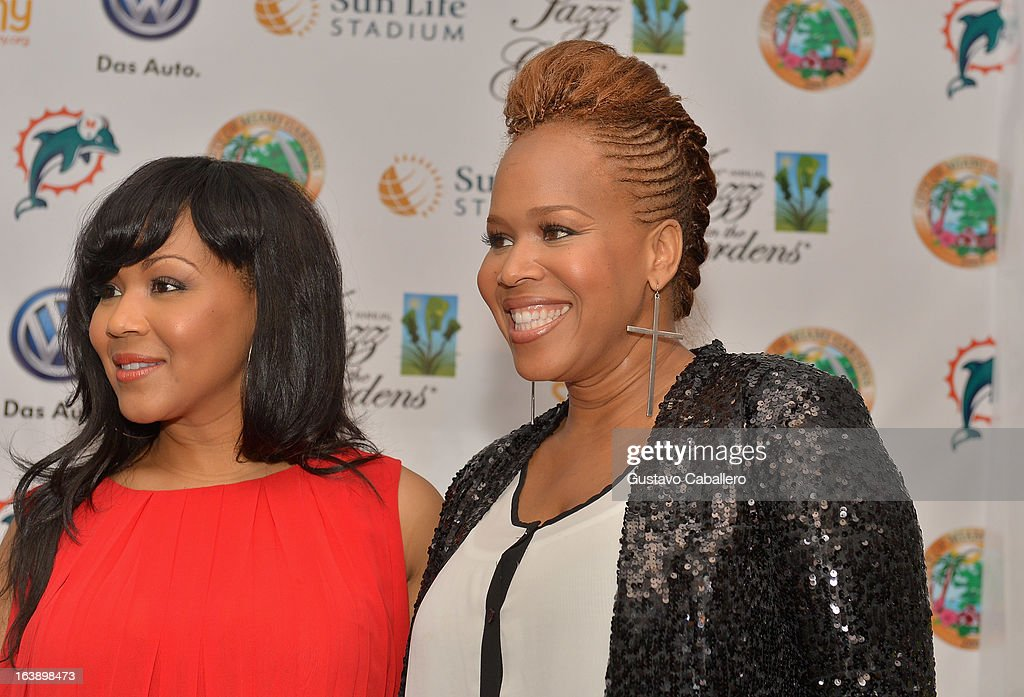 Erica Atkins-Campbell and Tina Atkins-Campbell of Mary Mary attend the 8th Annual Jazz in the Gardens Day 2 at Sun Life Stadium presented by the City of Miami Gardens on March 17, 2013 in Miami Gardens, Florida.