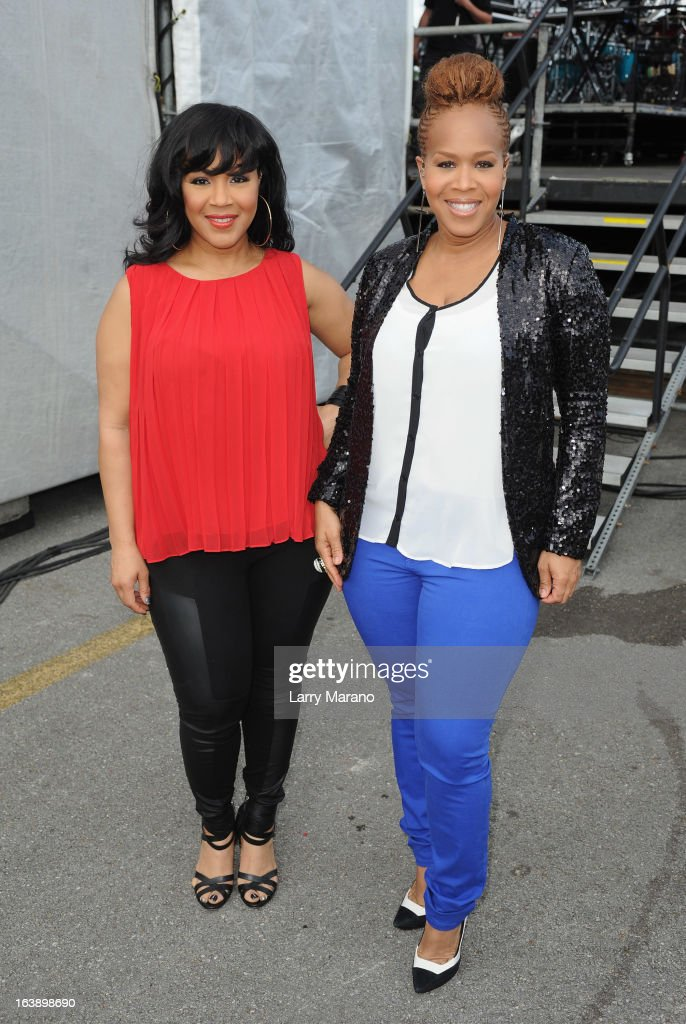 Erica Atkins-Campbell and Tina Atkins-Campbell of Mary Mary pose backstage at the 8th Annual Jazz in the Gardens Day 2 at Sun Life Stadium presented by the City of Miami Gardens on March 17, 2013 in Miami Gardens, Florida.
