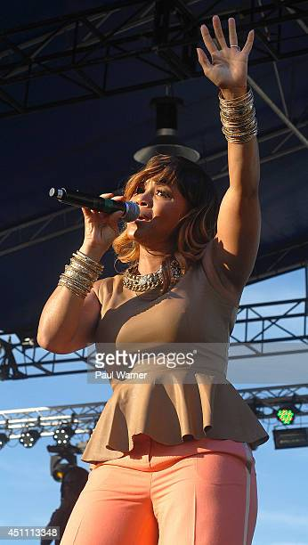 Erica Campbell of the gospel group Mary Mary performs during Detroit River Days 2014 at the Detroit Riverfront on June 22 2014 in Detroit Michigan