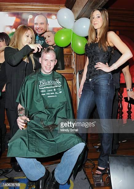 Erica Davis John Fitzgerald and Fantasy Girl Soolin shave heads for charity at Ri Ra Irish Pub on March 3 2012 in Las Vegas Nevada