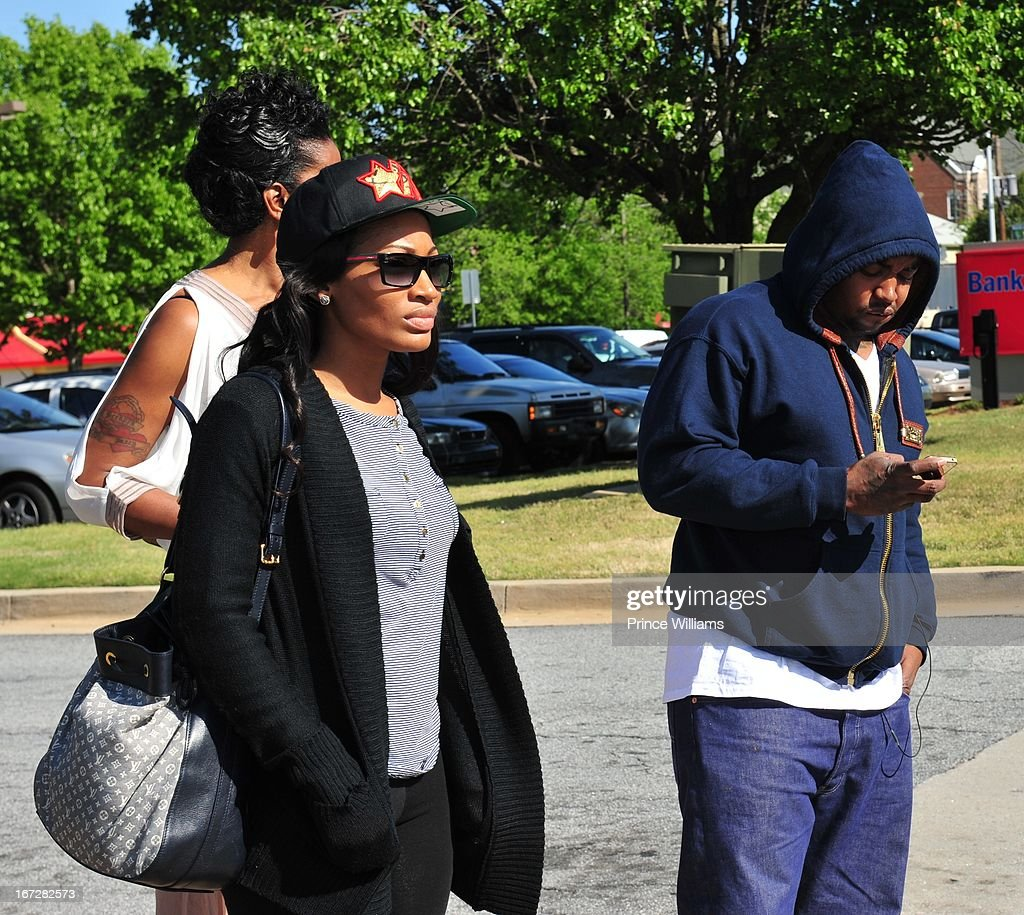 Erica Dixon and <a gi-track='captionPersonalityLinkClicked' href=/galleries/search?phrase=Lil+Scrappy&family=editorial&specificpeople=775495 ng-click='$event.stopPropagation()'>Lil Scrappy</a> <a gi-track='captionPersonalityLinkClicked' href=/galleries/search?phrase=Lil+Scrappy&family=editorial&specificpeople=775495 ng-click='$event.stopPropagation()'>Lil Scrappy</a> Turns Himself In at Atlanta Police Department on April 23, 2013 in Atlanta, Georgia.